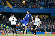 Diego Costa of Chelsea leaps to head the ball over Muhamed Bezic of Everton and Gareth Barry of Everton. Barclays Premier league match, Chelsea v Everton at Stamford Bridge in London on Saturday 16th January 2016.<br /> pic by John Patrick Fletcher, Andrew Orchard sports photography.