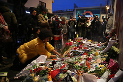 © Licensed to London News Pictures. 11/01/2016. Flowers are placed in tribute in front of a mural of David Bowie. The Death of David Bowie has been announced. Bowie was born in Brixton.  Photo credit: Peter Macdiarmid/LNP