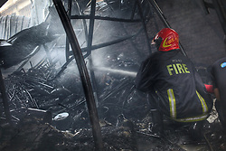 March 30, 2019 - Dhaka, Bangladesh - A fire broke out at DNCC market in the morning in Gulshan,  Dhaka, Bangladesh on Saturday, 30 March 2019. ..In March 28, 2019 just two days before from today at least twenty-five people died in a  fire incident occured in Banani, Dhaka, Bangladesh. (Credit Image: © Syed Mahamudur Rahman/NurPhoto via ZUMA Press)