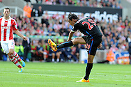 Marouane Chamakh of Crystal Palace shoots and scores the 1st goal.Barclays Premier league match, Stoke city v Crystal Palace at the Britannia Stadium in Stoke on Trent on Saturday 24th August 2013. pic by Andrew Orchard , Andrew Orchard sports photography,