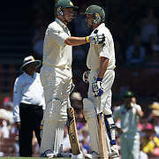 Peter Siddle (left) and Michael Hussey congratulate each other after their century partnership during the Australia V Pakistan 2nd Cricket Test match at the Sydney Cricket Ground, Sydney, Australia, 6 January 2010. Photo Tim Clayton