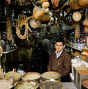 A man sits in his spice shop in the Al-Hamidiyah Souq in Damascus, Syria