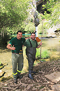 Two male environmental workers at Cueva del Gato, Benaojan, Serrania de Ronda, Malaga province, Spain