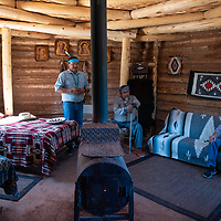 Kevin Begay, left, Kelly Wood Begay Sr., center and Dr. Eduardo Valda, right, welcome people to the Hózhó Sheep Camp bed and breakfast on September 21, 2019, as they hold a blessing ceremony for the hogan.