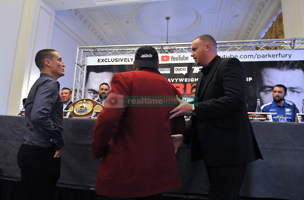 WBO world heavyweight title challenger Hughie Fury (far right), who will fight WBO champion Joseph Parker (third left) in Manchester on Saturday, watche as security usher away boxing promoter David Higgins (left) and an unidentified colleague (centre) after they interrupted a pre-fight press conference at the Landmark Hotel, London.