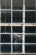 A man is seen standing by a window as he talks on his phone during COVID-19 in Melbourne, Australia. Premier Daniel Andrews announced today that some minor changes will be made to the current Stage 4 Restrictions in Melbourne. As yet, there is no sign of any meaningful change despite numbers of new cases being under 5 for the 14 day rolling average. Zero cases and no deaths were recorded in the past 24 hours in Victoria. (Photo by Dave Hewison/Speed Media)