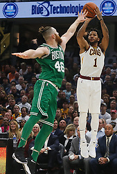 October 17, 2017 - Cleveland, OH, USA - The Cleveland Cavaliers' Derrick Rose puts up a 3-pointer against the Boston Celtics' Aron Baynes in the second quarter on Tuesday, Oct. 17, 2017, at Quicken Loans Arena in Cleveland. (Credit Image: © Leah Klafczynski/TNS via ZUMA Wire)