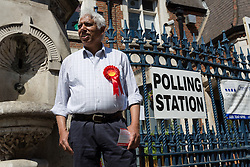 © Licensed to London News Pictures. 11/06/2015. London, UK. Election petitioner and Labour supporter, AZMAL HUSSAIN canvassing outside a polling station in Brick Lane, Tower Hamlets, east London. Tower Hamlets residents go to the polls today to vote for a new Mayor of Tower Hamlets after Lutfur Rahman was removed from office for fraud and corrupt practices by an election court earlier this year in an action brought by four petitioners which included AZMAL HUSSAIN. Photo credit : Vickie Flores/LNP