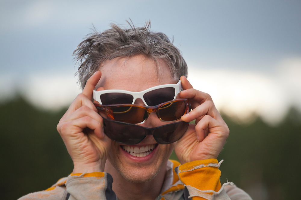 David Coffey watches the solar eclipse through three pairs of sunglasses on May 20, 2012 near Pine, Colorado.