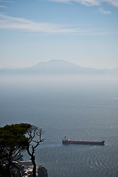 The coast of Africa seen from the top of the Rock of Gibraltar. Images of Gibraltar, the British overseas territory located on the southern end of the Iberian Peninsula at the entrance of the Mediterranean.