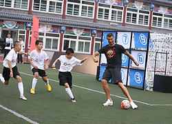 BEIJING, July 19, 2018  Portuguese football player Cristiano Ronaldo plays football with students as he attends a promotional event in Beijing, China, on July 19, 2018. (Credit Image: © Cao Can/Xinhua via ZUMA Wire)