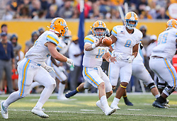 Sep 11, 2021; Morgantown, West Virginia, USA; Long Island Sharks quarterback Camden Orth (12) pitches to Long Island Sharks running back Kevin Wilson (34) during the second quarter against the West Virginia Mountaineers at Mountaineer Field at Milan Puskar Stadium. Mandatory Credit: Ben Queen-USA TODAY Sports