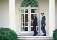 Washington, DC 1984/12/01<br /> Presdient Ronald Reagan walks along the colonade to the oval Office with a Secret Service agent close behind.  This image was the cover of the agent's book on his time with the Secret Serice. <br /> <br /> Photograph by Dennis Brack