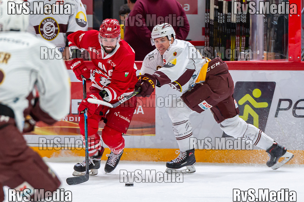 LAUSANNE, SWITZERLAND - NOVEMBER 23: #40 Etienne Froidevaux of Lausanne HC battles for the puck with #85 Marco Miranda of Geneve-Servette HC during the Swiss National League game between Lausanne HC and Geneve-Servette HC at Vaudoise Arena on November 23, 2019 in Lausanne, Switzerland. (Photo by Monika Majer/RvS.Media)
