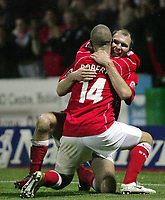 Fotball<br /> England 2004/2005<br /> Foto: SBI/Digitalsport<br /> NORWAY ONLY<br /> <br /> Swindon Town v Hull City<br /> The Coca-Cola Football League one. County Ground.<br /> 20/11/2004<br /> <br /> Swindon's Christian Roberts celebrates his scoring the fourth goal with third goal scorer Sam Parkin