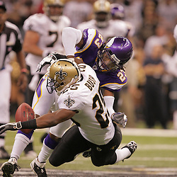 2008 October, 06: Minnesota Vikings cornerback Cedric Griffin (23) forces a fumble by New Orleans Saints running back Reggie Bush (25) during the first half of a week five regular season game between the Minnesota Vikings and the New Orleans Saints for Monday Night Football at the Louisiana Superdome in New Orleans, LA.