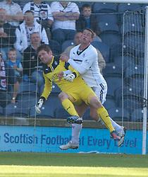 Raith Rovers Calum Elliot in on Falkirk's keeper Michael McGovern.<br /> Half time : Raith Rovers 1 v 0 Falkirk, Scottish Championship 28/9/2013.<br /> ©Michael Schofield.