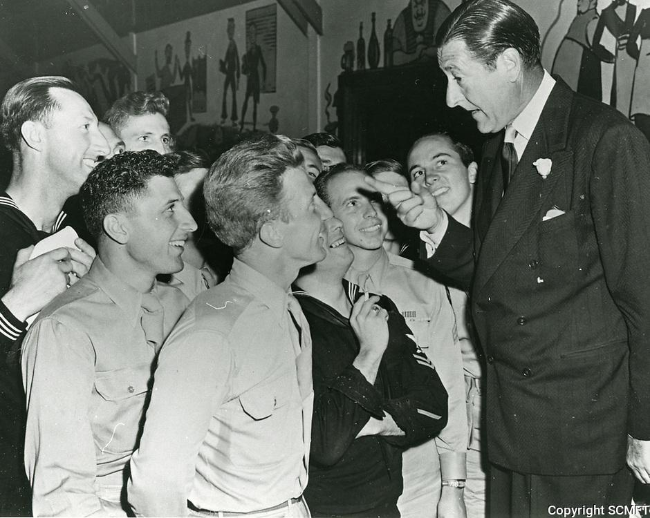 1943 Actor Arthur Treacher tells a joke to the visiting servicemen at the Hollywood Canteen.
