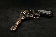 Webley Mark VI revolver with burst barrel and six visible bullets.