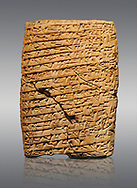 Hittite cuneiform tablet. Adana Archaeology Museum, Turkey. Against a grey background .<br /> <br /> If you prefer to buy from our ALAMY STOCK LIBRARY page at https://www.alamy.com/portfolio/paul-williams-funkystock/hittite-art-antiquities.html . Type - Adana - in LOWER SEARCH WITHIN GALLERY box. Refine search by adding background colour, place, museum etc<br /> <br /> Visit our HITTITE PHOTO COLLECTIONS for more photos to download or buy as wall art prints https://funkystock.photoshelter.com/gallery-collection/The-Hittites-Art-Artefacts-Antiquities-Historic-Sites-Pictures-Images-of/C0000NUBSMhSc3Oo