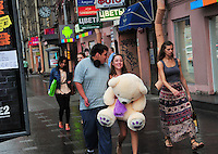 Young love and a huge teddy bear on the streets of St. Petersburg, Russia.