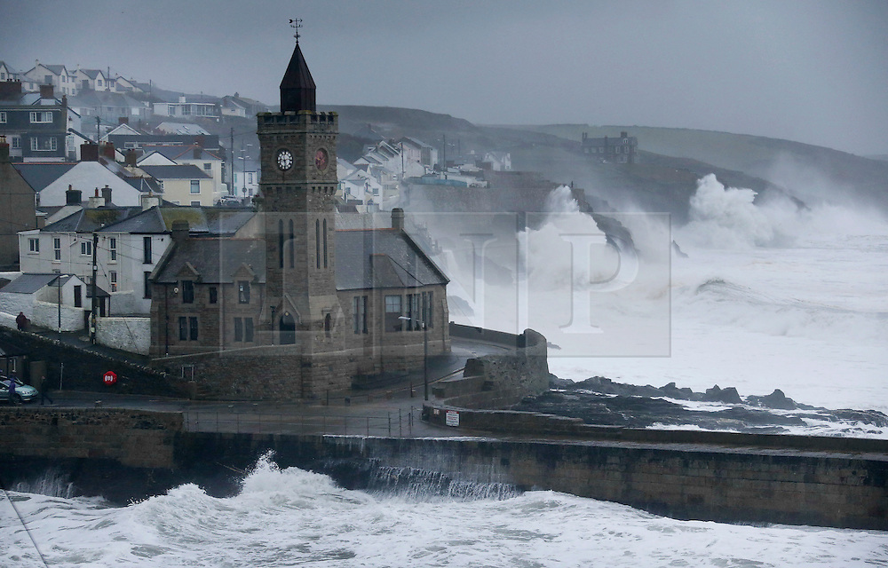 © London News Pictures. 30/12/2015. PORTHLEVEN , UK. Large waves crash up on to the cliffs at Porthleven in Cornwall, England in front of a house as storm Franck hit's the uk shores. Photo credit: Jason Bryant/LNP