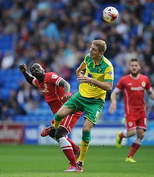 Cardiff City's Kenwyne Jones flicks the ball over Norwich's Michael Turner - Photo mandatory by-line: Alex James/JMP - Mobile: 07966 386802 30/08/2014 - SPORT - FOOTBALL - Cardiff - Cardiff City stadium - Cardiff City  v Norwich City - Barclays Premier League