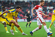 Herbie Kane of Doncaster Rovers (15) controls the ball away from Will Nightingale of AFC Wimbledon (5) during the EFL Sky Bet League 1 match between Doncaster Rovers and AFC Wimbledon at the Keepmoat Stadium, Doncaster, England on 17 November 2018.