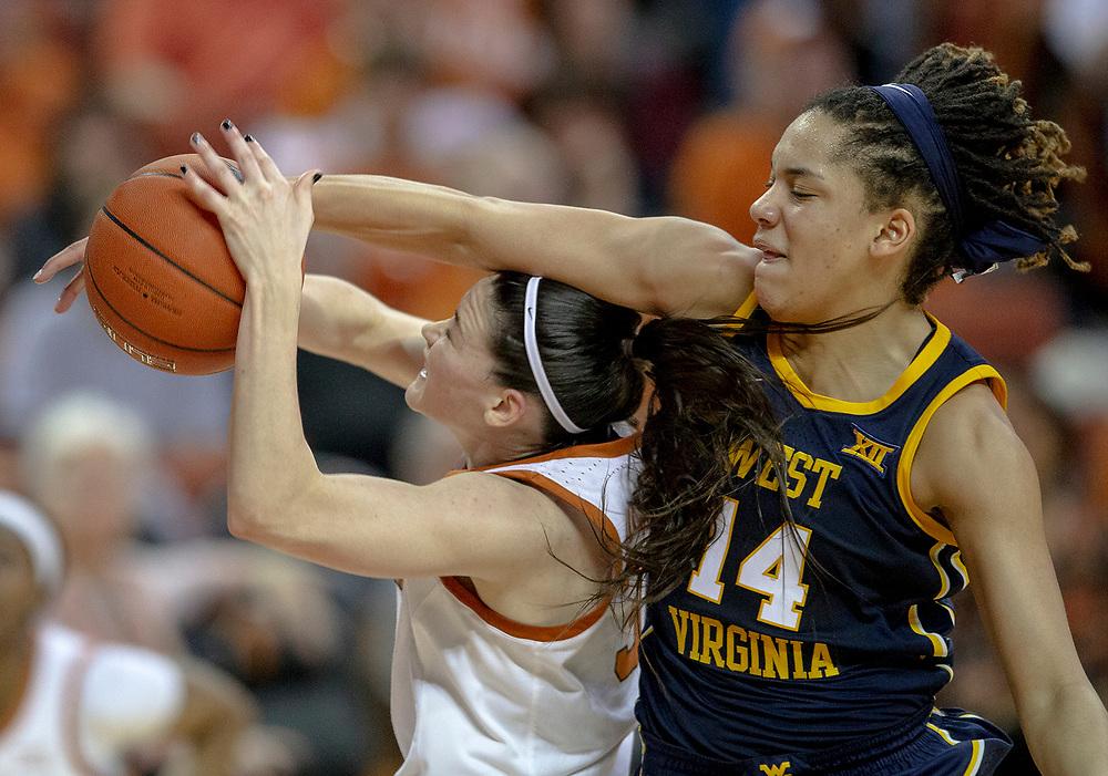 West Virginia forward Kari Niblack (14) fouls Texas guard Danni Williams (3) during an NCAA women's basketball game on Monday, Jan. 28, 2019, in Austin, Texas. [NICK WAGNER/AMERICAN-STATESMAN]