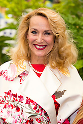 © Licensed to London News Pictures. 19/05/2014. London, England. Model Jerry Hall at a photocall.  Press Day at the RHS Chelsea Flower Show. On Tuesday, 20 May 2014 the flower show will open its doors to the public.  Photo credit: Bettina Strenske/LNP