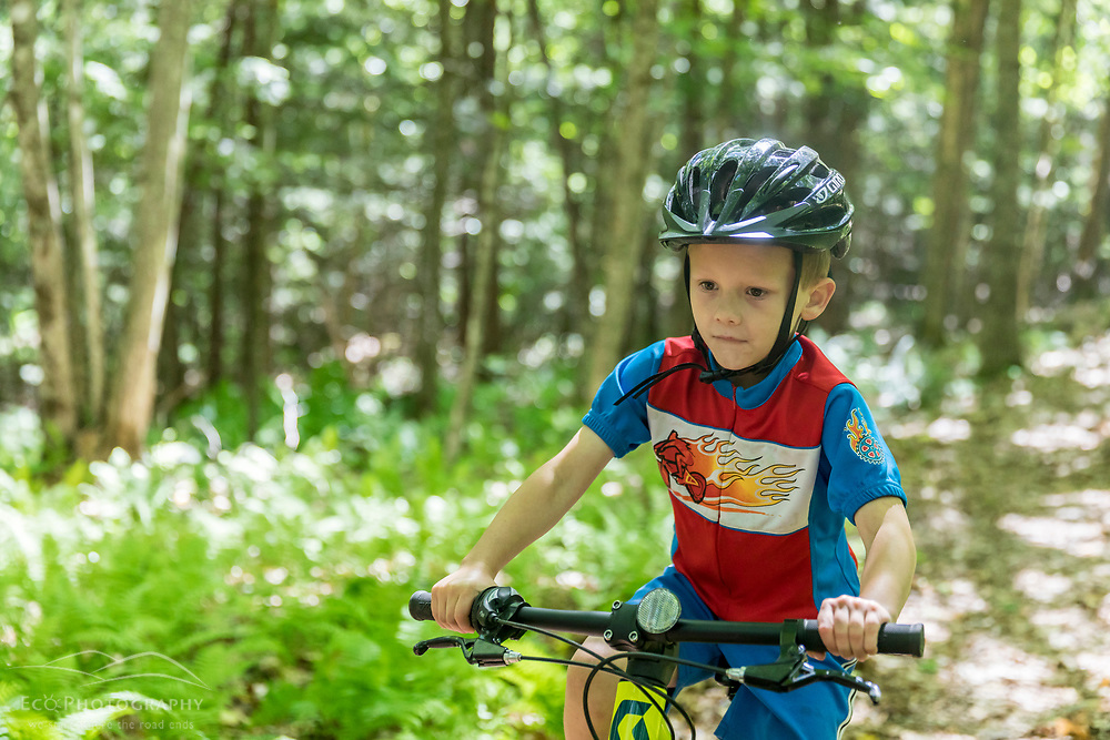 A boy rides his mountain bike at the Shepards Farms Preserve in Norway, Maine.