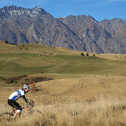 A Competitor tackles the course with The Remarkables mountain range providing the backdrop during the New Zealand Cyclocross Championships sponsored by AJ Hackett Bungy, held at Jardine Park,  Queenstown, as part of the Queenstown WInter Festival. The men's event was won by Dan Warren from Hastings while Anja McDonald from Dunedin won the women's event. Queenstown, New Zealand, 3rd July 2011