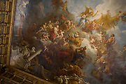 Ceiling detail of Hercules Apotheosis of Hercules 1733-1736 by François Le Moyne, (1688-1737) in the the King's Grand Apartment, Palace of Versaille, Paris. The salon d'Hercule (also known as the Hercules Salon or the Hercules Drawing Room) is on the first floor of the Château de Versailles and connects the chapel and the North Wing of the château with grand appartement du roi. Beginning in 1724, work on the salon d'Hercule recommenced. Louis XV commissioned architect Jacques Gabriel, marbrier Claude-Félix Tarlé, and sculptors Jacques Verberckt and François-Antoine Vassé to complete the room