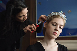 © London News Pictures. 03/04/15. London, UK. A diamond tiara made by Cartier in the 1930's from the estate of Mary, Duchess of Roxburghe is put onto a model as part of press view for the magnificient jewels sale at Sotheby's, central London. Photo credit: Laura Lean/LNP