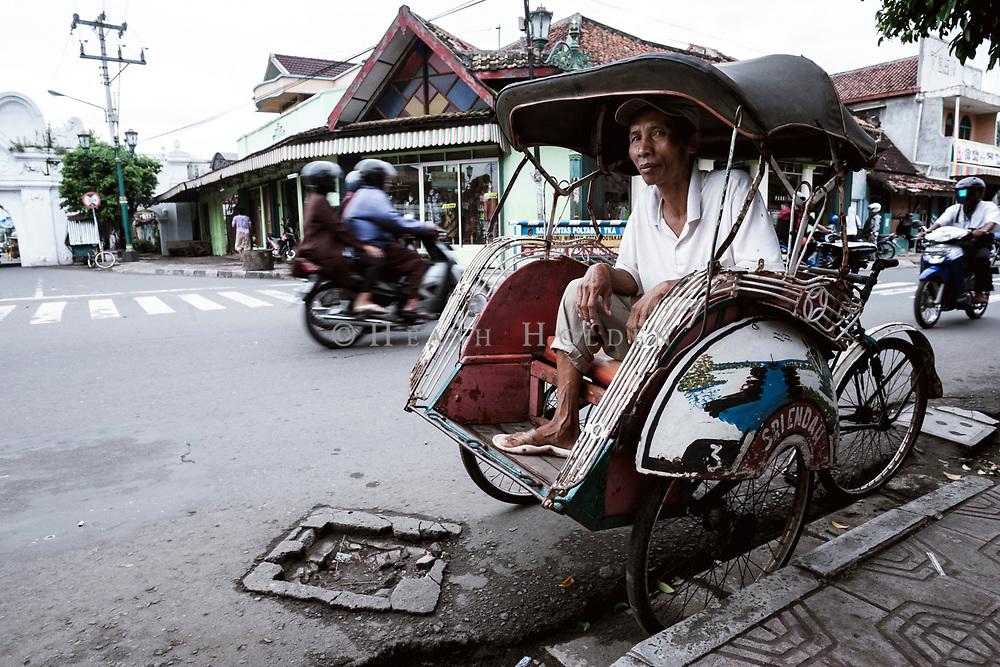 Bekaks are plentiful in Yogyakarta, this rider waits for some passengers