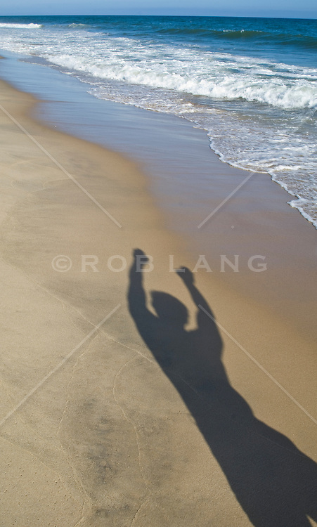 Shadow of a man on the beach in East Hampton, NY