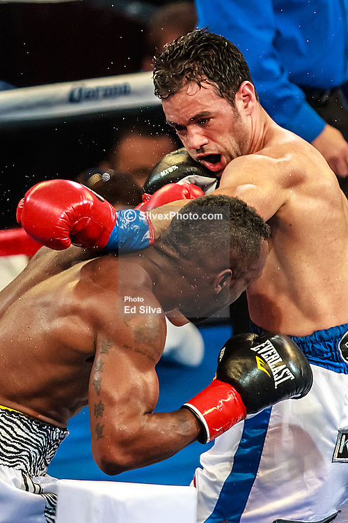 CARSON - JUNE 02: Delvin Rodriguez (24-0) (blue striped white trunks) lost to Austin Trout (25-0),  by scores of 117-111, from judge Jerry Cantu, 118-110 from judge Marshall Walker and 120-108 from judge Alejandro Rochin. It was Trout's third title defense. All fees must be ageed prior to publication,.Byline and/or web usage link must read PHOTO Eduardo E. Silva/SILVEX.PHOTOSHELTER.COM Failure to byline correctly will incur double the agreed fee.