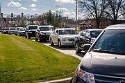 "15 NOVEMBER 2020 - WEST DES MOINES, IOWA: People sit in the cars in line for a drive up rapid COVID test. Hundreds of people lined up for drive up COVID-19 tests at the Doctors NOW clinic in West Des Moines. Iowa is seeing a surge in COVID-19 (Coronavirus) cases and the state's ""Test Iowa"" public testing program is swamped with some people waiting 3 - 5 days for an appointment for a drive up test. As of Sunday, 15 November, Iowa had the 3rd highest Coronavirus (SARS-CoV-2) infection rate in the country with 4,432 new cases reported in the previous 24 hours and 1,279 people hospitalized for COVID-19. Des Moines area hospitals have warned that they are at capacity and many hospitals are reporting staffing shortages because workers have come down with COVID-19.     PHOTO BY JACK KURTZ"