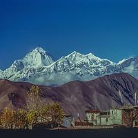 The Dhaulagiri massif rises behing a village near Muktinath, Nepal.