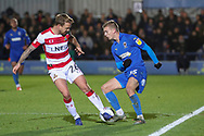 AFC Wimbledon attacker Marcus Forss (15) dribbling past Doncaster Rovers midfielder James Coppinger (26) during the EFL Sky Bet League 1 match between AFC Wimbledon and Doncaster Rovers at the Cherry Red Records Stadium, Kingston, England on 14 December 2019.