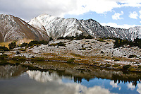 First snow of the autumn season on 13,427 ft. Grizzly Peak along the Continental Divide.   Viewed from Loveland Pass, Colorado.