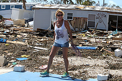 Patty Purdo checks the damage at the Seabreeze trailer park along the Overseas Highway in the Florida Keys on Tuesday, September 12, 2017. Photo by Al Diaz/Miami Herald/TNS/ABACAPRESS.COM
