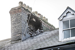 © London News Pictures. Aberystwyth,UK. 17/11/2016.<br /> Damage to a chimney on a property roof. A tornado , with winds of over 80mph, reportedly tore through the town of Aberystwyth on the morning of Nov 17, bringing extensive damage in its wake.  Slates were blown off roofs, windows sucked out, and chimney stacks destroyed, Large  parts of the town have been closed to traffic and pedestrians because of the risk of further damage. Photo credit: Keith Morris/ LNP