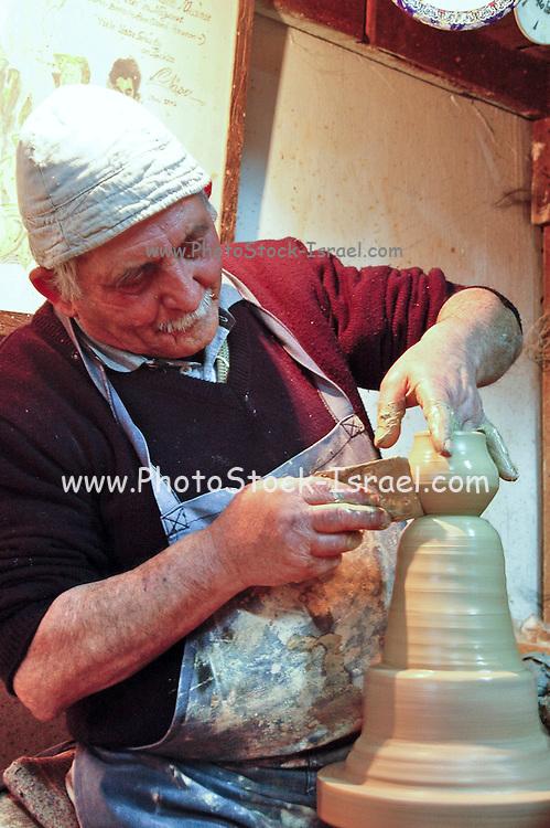 Mature potter in his workshop