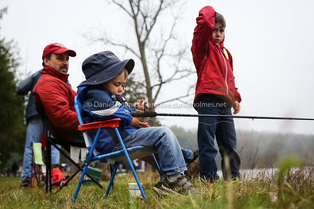 (5/7/16, WESTBOROUGH, MA) Matt Lane, 4, his brother Steven, 7, and dad Rob, of Grafton, try their luck during the Civic Club Fishing Challenge that was part of the Westborough Rotary Club's annual spring festival at Westborough Reservoir in Westborough on Saturday. Daily News and Wicked Local Photo/Dan Holmes