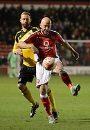 James O'Connor clears the ball during the Sky Bet League 1 match between Walsall and Sheffield Utd at the Banks's Stadium, Walsall, England on 17 March 2015. Photo by Alan Franklin.