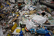 The damage and detritus of shop stock in the damaged Clarence Road Convenience Store belonging to Sri Lankan-born Sivaharan (Siva) Kandiah during the riots of London and other UK cities of August 2011. The local newspaper Hackney Gazette lies in shreds on the floor of the premises along with various other paper and goods, even electrical wiring that was ripped out. During the riot in London on Monday 8th August, local youths and older residents of nearby estates ransacked the business and either removed Siva's stock or left the rest to spoil on the unrefrigerated floor. In alcohol and cigarettes alone, he lost £50,000 in stock but during the campaign top help him recover, more than £16,000 was raised by his customers and friends.