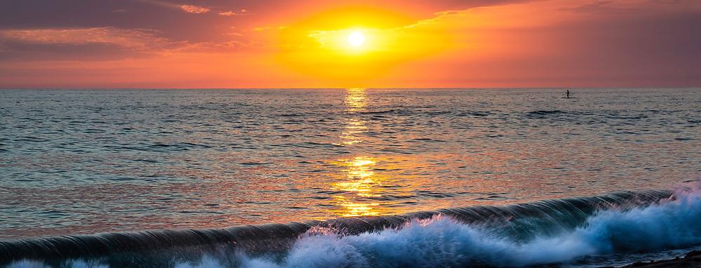 Paddle Boarding During Sunset At Tamarac Beach In Carlsbad California