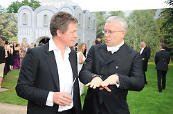 Left to right, HUGH GRANT and ALEXANDER LEBEDEV at the Raisa Gorbachev Foundation Party held at Stud House, Hampton Court Palace on 5th June 2010.  The night is in aid of the Raisa Gorbachev Foundation, an international fund fighting child cancer.