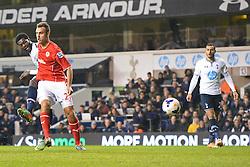 Tottenham's Emmanuel Adebayor takes a shot at goal - Photo mandatory by-line: Mitchell Gunn/JMP - Tel: Mobile: 07966 386802 02/03/2014 - SPORT - FOOTBALL - White Hart Lane - London - Tottenham Hotspur v Cardiff City - Premier League